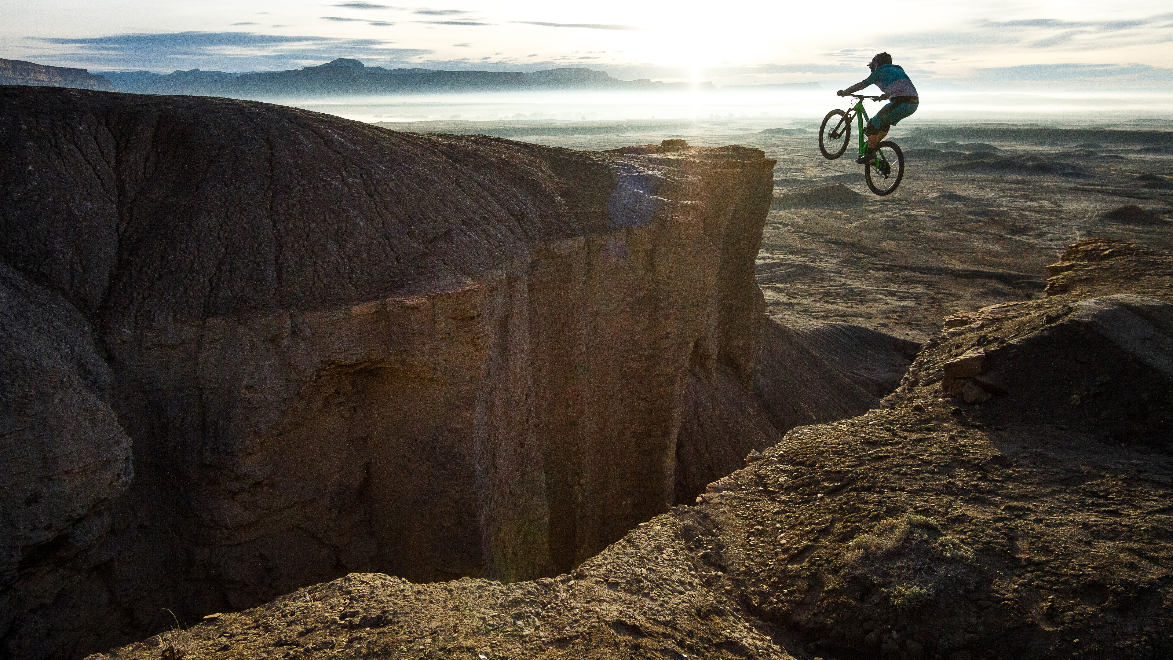 Mountain bicyclist flies over a canyon  in this promotional photograph taken near  Green River Wyoming